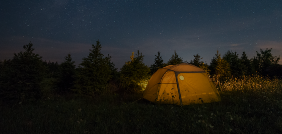 Tent outdoors at night