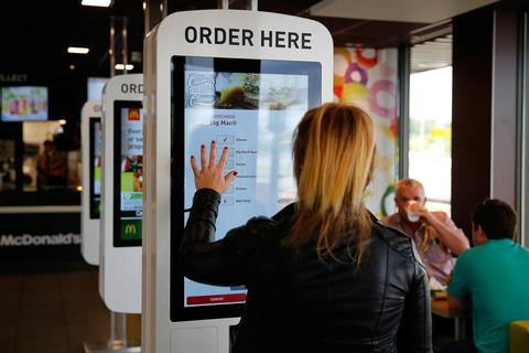 customer ordering on mcdonalds self-serve screen