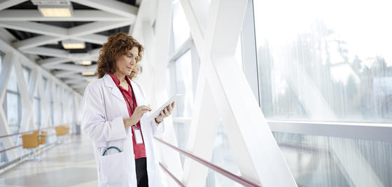 healthcare worker in front of large window