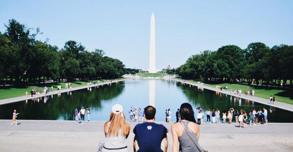 people sitting in front of the Washington monument