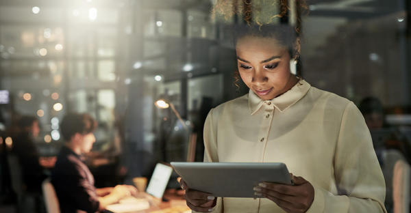 Business woman holding a tablet