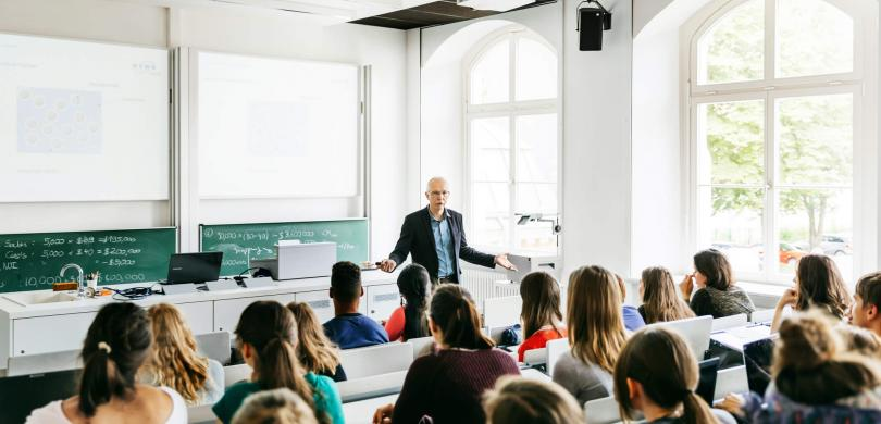 Professor lecturing in front of students
