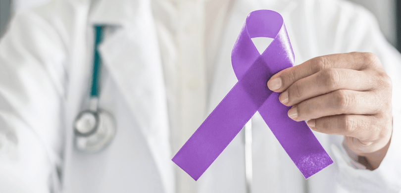 Doctor holding purple ribbon