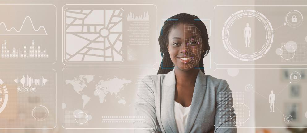 African American businesswoman with info on virtual display